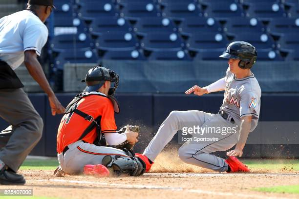 Catcher Will Banfield sets up to tag Marlins runner Dylan Jennings during the East Coast Pro Showcase on August 01 at Steinbrenner Field in Tampa FL