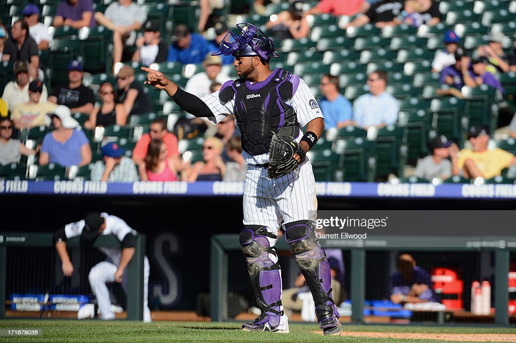 Catcher Willin Rasario #20 of the Colorado Rockies gestures to the pitcher during a game against the New York Mets at Coors Field on June 27, 2013 in Denver, Colorado. Photo by Garrett W. Ellwood/Getty Images)
