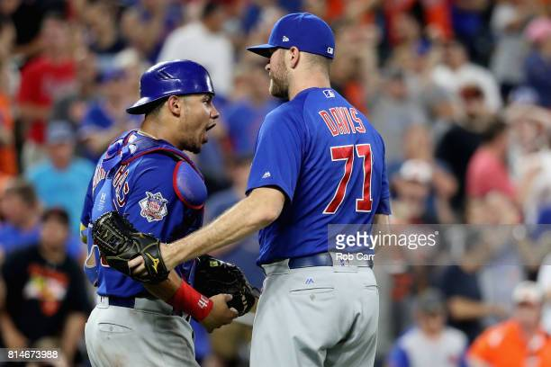 Catcher Willson Contreras of the Chicago Cubs and pitcher Wade Davis celebrate after defeating the Baltimore OrioleTerry Pendleton of the Atlanta...