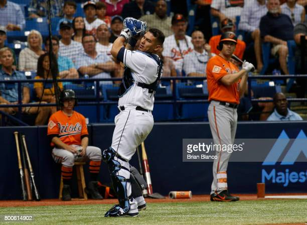 Catcher Wilson Ramos of the Tampa Bay Rays hauls in the pop foul by Paul Janish of the Baltimore Orioles to end the top of the fourth inning of a...