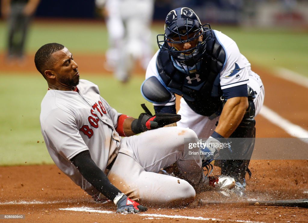 Catcher Wilson Ramos #40 of the Tampa Bay Rays tags Eduardo Nunez #36 of the Boston Red Sox out at home off of the fielder's choice by Hanley Ramirez during the first inning of a game on August 9, 2017 at Tropicana Field in St. Petersburg, Florida.