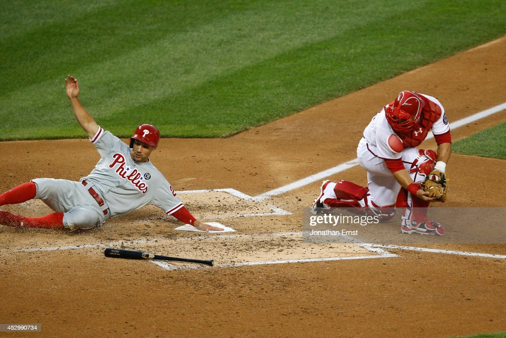 Catcher <a gi-track='captionPersonalityLinkClicked' href=/galleries/search?phrase=Wilson+Ramos&family=editorial&specificpeople=4866956 ng-click='$event.stopPropagation()'>Wilson Ramos</a> #40 (R) of the Washington Nationals looks back to see <a gi-track='captionPersonalityLinkClicked' href=/galleries/search?phrase=Grady+Sizemore&family=editorial&specificpeople=215505 ng-click='$event.stopPropagation()'>Grady Sizemore</a> #24 of the Phildelphia Phillies score on a feilder's choice by Domonic Brown in the fourth inning at Nationals Park on July 31, 2014 in Washington, DC.