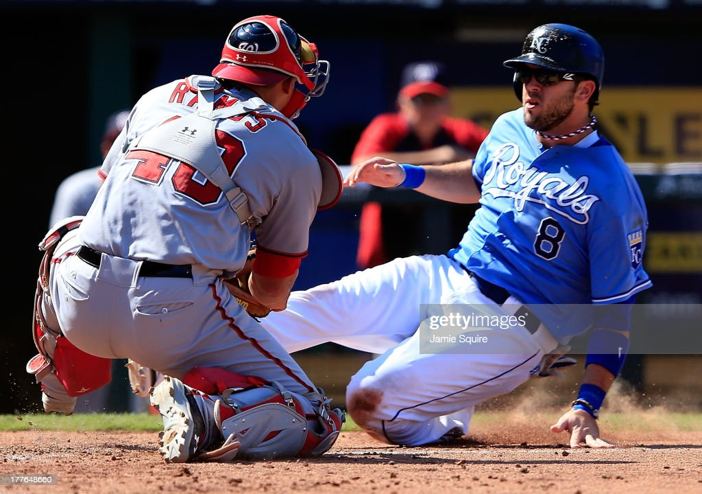 Catcher <a gi-track='captionPersonalityLinkClicked' href=/galleries/search?phrase=Wilson+Ramos&family=editorial&specificpeople=4866956 ng-click='$event.stopPropagation()'>Wilson Ramos</a> #40 of the Washington Nationals tags out <a gi-track='captionPersonalityLinkClicked' href=/galleries/search?phrase=Mike+Moustakas&family=editorial&specificpeople=6780077 ng-click='$event.stopPropagation()'>Mike Moustakas</a> #8 of the Kansas City Royals while trying to score during the 8th inning of the game at Kauffman Stadium on August 25, 2013 in Kansas City, Missouri.
