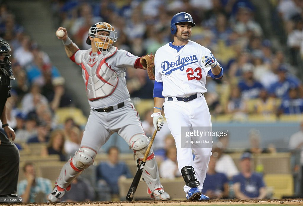 Catcher Wilson Ramos of the Washington Nationals throws to second to catch Corey Seager of the Los Angeles Dodgers stealing after a strkeout by...