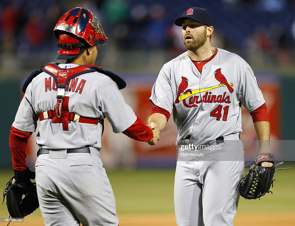 Catcher <a gi-track='captionPersonalityLinkClicked' href=/galleries/search?phrase=Yadier+Molina&family=editorial&specificpeople=172002 ng-click='$event.stopPropagation()'>Yadier Molina</a> #4 of the St. Louis Cardinals congratulates pitcher <a gi-track='captionPersonalityLinkClicked' href=/galleries/search?phrase=Mitchell+Boggs&family=editorial&specificpeople=4948327 ng-click='$event.stopPropagation()'>Mitchell Boggs</a> #41 after the final out as the Cardinals defeated the Philadelphia Phillies 5-0 in a MLB baseball game on April 20, 2013 at Citizens Bank Park in Philadelphia, Pennsylvania.