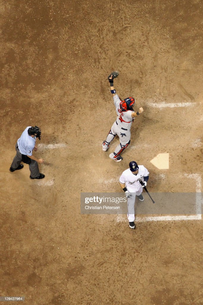 Catcher <a gi-track='captionPersonalityLinkClicked' href=/galleries/search?phrase=Yadier+Molina&family=editorial&specificpeople=172002 ng-click='$event.stopPropagation()'>Yadier Molina</a> #4 of the St. Louis Cardinals reacts after <a gi-track='captionPersonalityLinkClicked' href=/galleries/search?phrase=Mark+Kotsay&family=editorial&specificpeople=215516 ng-click='$event.stopPropagation()'>Mark Kotsay</a> #25 of the Milwaukee Brewers for the final out of the Game Six of the National League Championship Series which the Cardinals won 12-6 at Miller Park on October 16, 2011 in Milwaukee, Wisconsin.
