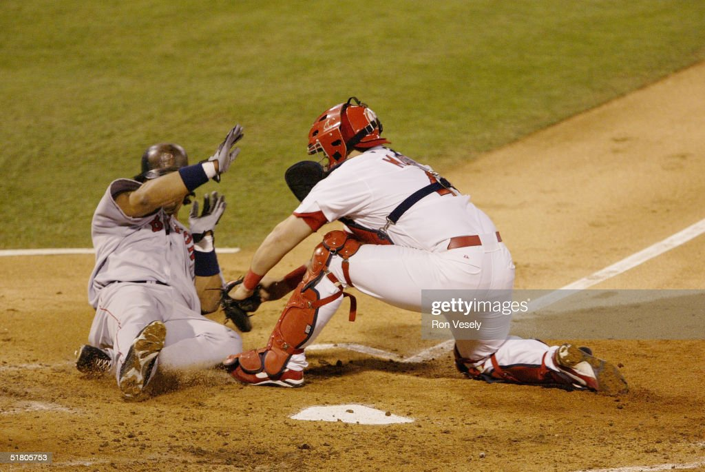 Catcher Yadier Molina of the St. Louis Cardinals tags out Manny Ramirez of the Boston Red Sox at home plate during game four of the 2004 World Series against the Boston Red Sox at Busch Stadium on October 27, 2004 in St. Louis, Missouri. The Red Sox defeated the Cardinals 3-0 to win their first World Series in 86 years.