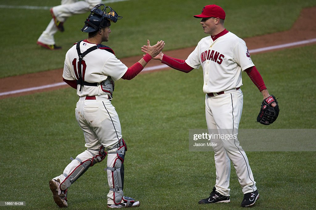Catcher <a gi-track='captionPersonalityLinkClicked' href=/galleries/search?phrase=Yan+Gomes&family=editorial&specificpeople=9004037 ng-click='$event.stopPropagation()'>Yan Gomes</a> #10 and closing pitcher <a gi-track='captionPersonalityLinkClicked' href=/galleries/search?phrase=Vinnie+Pestano&family=editorial&specificpeople=4583581 ng-click='$event.stopPropagation()'>Vinnie Pestano</a> #52 of the Cleveland Indians celebrate after defeating the Chicago White Sox at Progressive Field on April 13, 2013 in Cleveland, Ohio. The Indians defeated the White Sox 9-4.