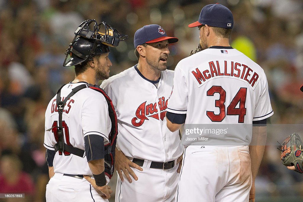 Catcher <a gi-track='captionPersonalityLinkClicked' href=/galleries/search?phrase=Yan+Gomes&family=editorial&specificpeople=9004037 ng-click='$event.stopPropagation()'>Yan Gomes</a> #10 and pitching coach <a gi-track='captionPersonalityLinkClicked' href=/galleries/search?phrase=Mickey+Callaway&family=editorial&specificpeople=3002338 ng-click='$event.stopPropagation()'>Mickey Callaway</a> #44 talk with starting pitcher <a gi-track='captionPersonalityLinkClicked' href=/galleries/search?phrase=Zach+McAllister&family=editorial&specificpeople=6816291 ng-click='$event.stopPropagation()'>Zach McAllister</a> #34 of the Cleveland Indians during the sixth inning against the Kansas City Royals at Progressive Field on September 10, 2013 in Cleveland, Ohio.