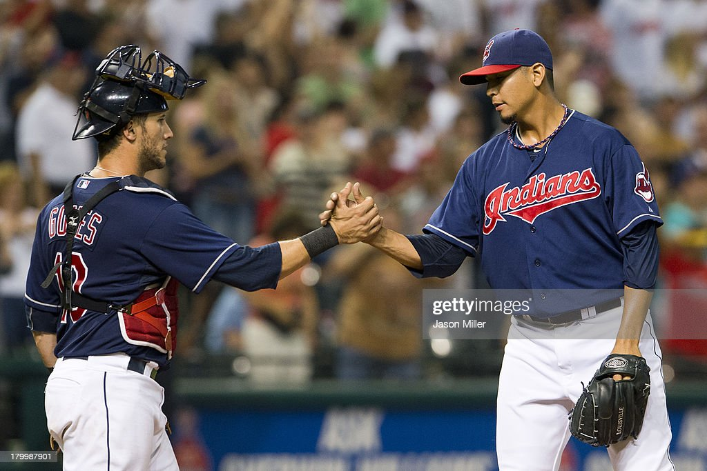 Catcher <a gi-track='captionPersonalityLinkClicked' href=/galleries/search?phrase=Yan+Gomes&family=editorial&specificpeople=9004037 ng-click='$event.stopPropagation()'>Yan Gomes</a> #10 celebrates with closing pitcher Carlos Carrasco #59 of the Cleveland Indians after the last out against the New York Mets at Progressive Field on September 7, 2013 in Cleveland, Ohio. The Indians defeated the Mets 9-4.
