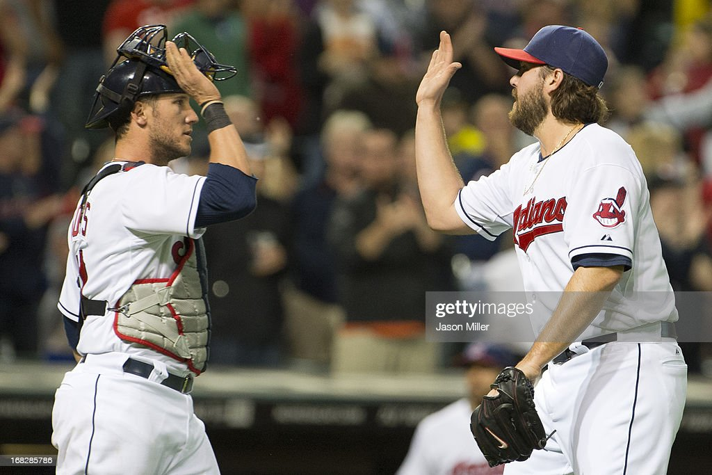 Catcher <a gi-track='captionPersonalityLinkClicked' href=/galleries/search?phrase=Yan+Gomes&family=editorial&specificpeople=9004037 ng-click='$event.stopPropagation()'>Yan Gomes</a> #10 celebrates with closing pitcher Chris Perez #54 of the Cleveland Indians after the Indians defeated the Oakland Athletics at Progressive Field on May 7, 2013 in Cleveland, Ohio. The Indians defeated the Athletics 1-0.