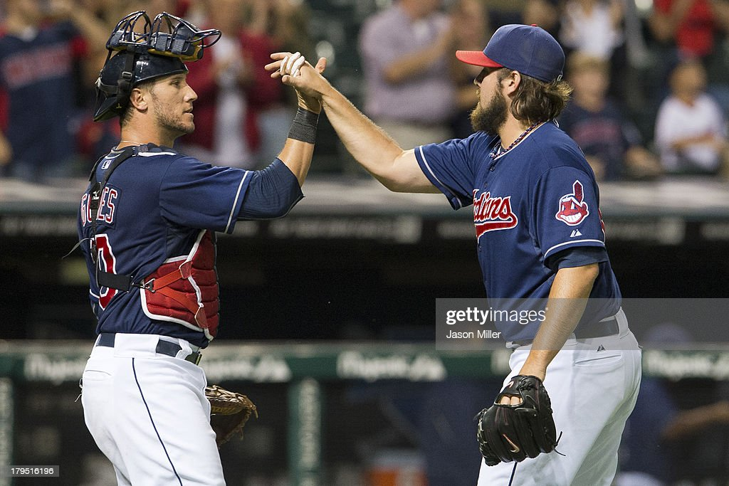 Catcher <a gi-track='captionPersonalityLinkClicked' href=/galleries/search?phrase=Yan+Gomes&family=editorial&specificpeople=9004037 ng-click='$event.stopPropagation()'>Yan Gomes</a> #10 celebrates with closing pitcher Chris Perez #54 of the Cleveland Indians after the Indians defeated the Baltimore Orioles at Progressive Field on September 4, 2013 in Cleveland, Ohio. The Indians defeated the Orioles 6-4.