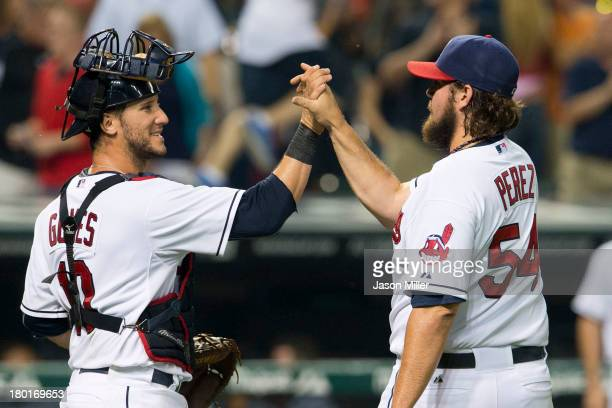 Catcher Yan Gomes celebrates with closing pitcher Chris Perez of the Cleveland Indians after the Indians defeated the Kansas City Royals at...