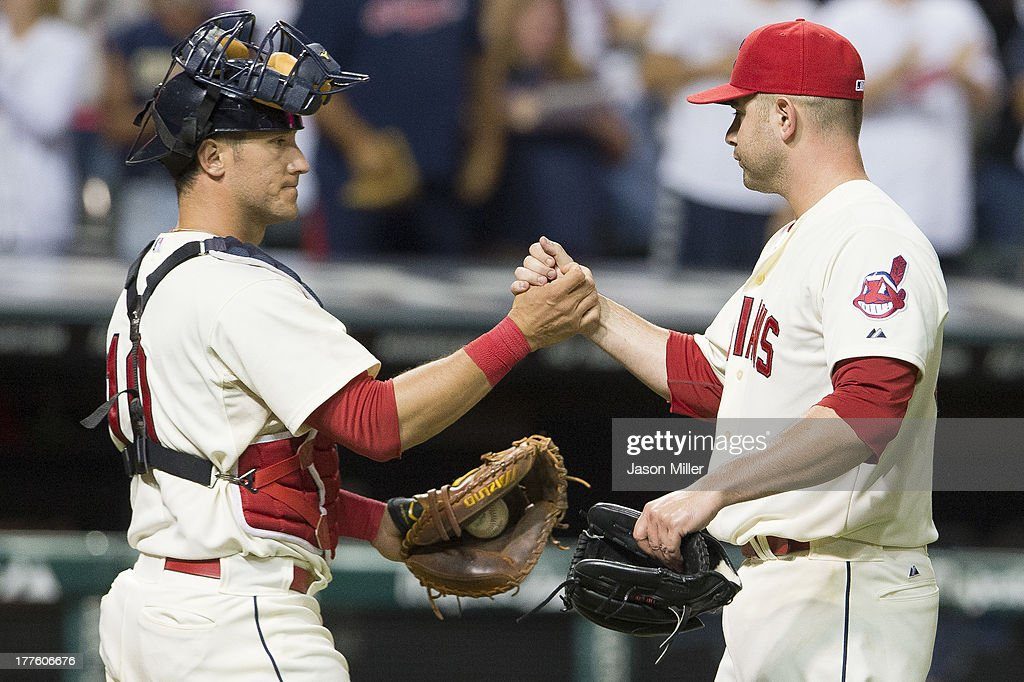 Catcher <a gi-track='captionPersonalityLinkClicked' href=/galleries/search?phrase=Yan+Gomes&family=editorial&specificpeople=9004037 ng-click='$event.stopPropagation()'>Yan Gomes</a> #10 celebrates with closing pitcher <a gi-track='captionPersonalityLinkClicked' href=/galleries/search?phrase=Marc+Rzepczynski&family=editorial&specificpeople=6134203 ng-click='$event.stopPropagation()'>Marc Rzepczynski</a> #35 of the Cleveland Indians after the Indians defeated the Minnesota Twins at Progressive Field on August 24, 2013 in Cleveland, Ohio. The Indians defeated the Twins 7-2.