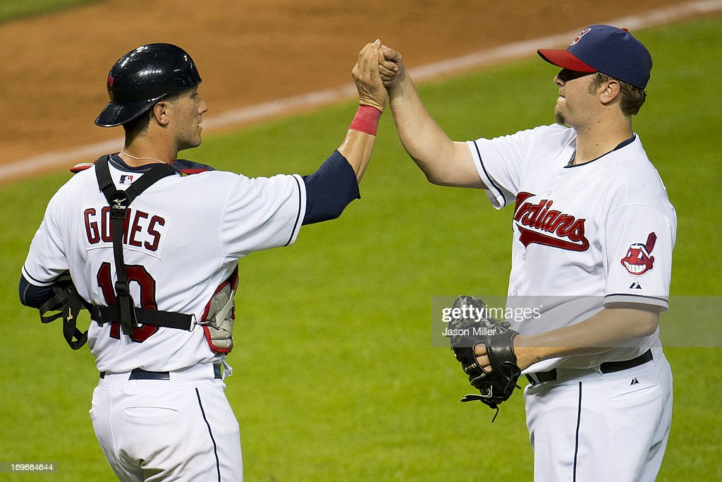 Catcher <a gi-track='captionPersonalityLinkClicked' href=/galleries/search?phrase=Yan+Gomes&family=editorial&specificpeople=9004037 ng-click='$event.stopPropagation()'>Yan Gomes</a> #10 celebrates with closing pitcher Matt Albers #32 of the Cleveland Indians after the Indians defeated the Cincinnati Reds at Progressive Field on May 30, 2013 in Cleveland, Ohio. The Indians defeated the Reds 7-1.