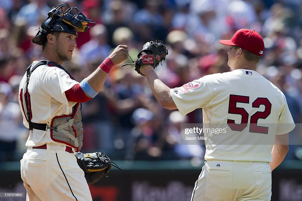 Catcher <a gi-track='captionPersonalityLinkClicked' href=/galleries/search?phrase=Yan+Gomes&family=editorial&specificpeople=9004037 ng-click='$event.stopPropagation()'>Yan Gomes</a> #10 celebrates with closing pitcher <a gi-track='captionPersonalityLinkClicked' href=/galleries/search?phrase=Vinnie+Pestano&family=editorial&specificpeople=4583581 ng-click='$event.stopPropagation()'>Vinnie Pestano</a> #52 of the Cleveland Indians after the Indians defeated the Washington Nationals at Progressive Field on June 16, 2013 in Cleveland, Ohio. The Indians defeated the Nationals 2-0.