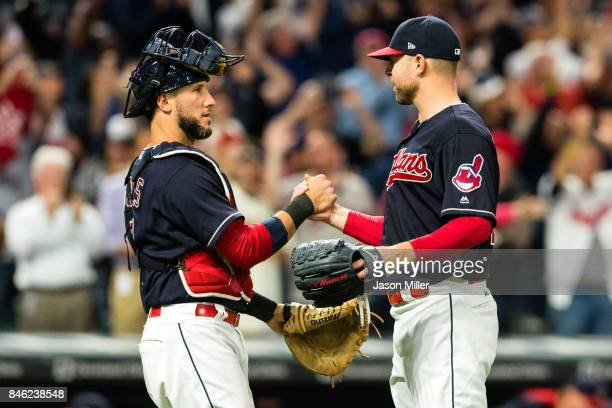 Catcher Yan Gomes celebrates with starting pitcher Corey Kluber of the Cleveland Indians after the Indians defeated the Detroit Tigers at Progressive...