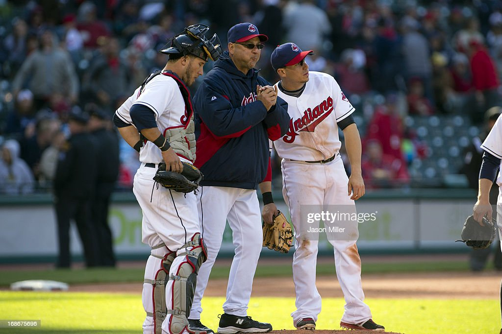Catcher <a gi-track='captionPersonalityLinkClicked' href=/galleries/search?phrase=Yan+Gomes&family=editorial&specificpeople=9004037 ng-click='$event.stopPropagation()'>Yan Gomes</a> #10 manager <a gi-track='captionPersonalityLinkClicked' href=/galleries/search?phrase=Terry+Francona&family=editorial&specificpeople=171936 ng-click='$event.stopPropagation()'>Terry Francona</a> #17 and shortstop <a gi-track='captionPersonalityLinkClicked' href=/galleries/search?phrase=Asdrubal+Cabrera&family=editorial&specificpeople=834042 ng-click='$event.stopPropagation()'>Asdrubal Cabrera</a> #13 of the Cleveland Indians talk on the mound during a pitching change in the sixth inning against the New York Yankees during the second game of a doubleheader at Progressive Field on May 13, 2013 in Cleveland, Ohio.