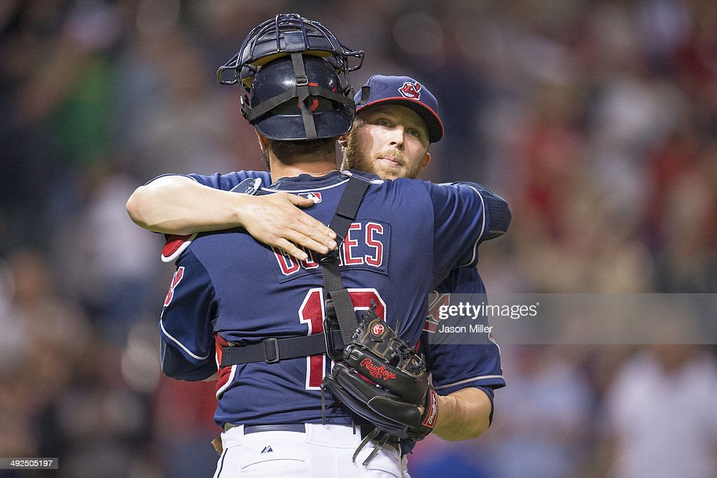 Catcher <a gi-track='captionPersonalityLinkClicked' href=/galleries/search?phrase=Yan+Gomes&family=editorial&specificpeople=9004037 ng-click='$event.stopPropagation()'>Yan Gomes</a> #10 of the Cleveland Indians celebrates with closing pitcher Cody Allen #37 after a win over the Detroit Tigers at Progressive Field on May 20, 2014 in Cleveland, Ohio. The Indians defeated the Tigers 6-2.