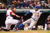 Catcher Yan Gomes of the Cleveland Indians tags out Alejandro De Aza of the New York Mets at home plate during the eighth inning at Progressive Field...