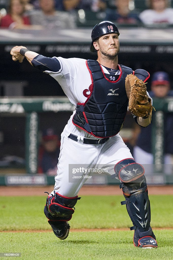 Catcher <a gi-track='captionPersonalityLinkClicked' href=/galleries/search?phrase=Yan+Gomes&family=editorial&specificpeople=9004037 ng-click='$event.stopPropagation()'>Yan Gomes</a> #10 of the Cleveland Indians throws out Emilio Bonifacio #64 of the Kansas City Royals at first during the seventh inning at Progressive Field on September 10, 2013 in Cleveland, Ohio.