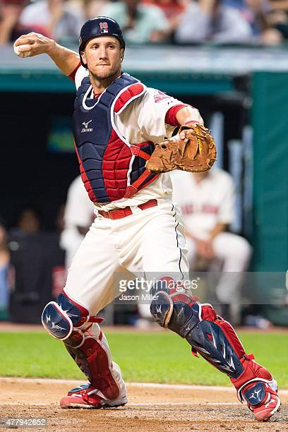 Catcher Yan Gomes of the Cleveland Indians throws out Joey Butler of the Tampa Bay Rays at first during the eighth inning at Progressive Field on...