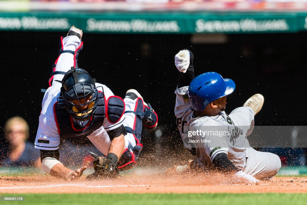 Catcher Yan Gomes #7 of the Cleveland Indians tries to tag Alcides Escobar #2 of the Kansas City Royals as he scores on a sacrifice fly by Salvador Perez #13 during the first inning against the Cleveland Indians at Progressive Field on May 27, 2017 in Cleveland, Ohio.