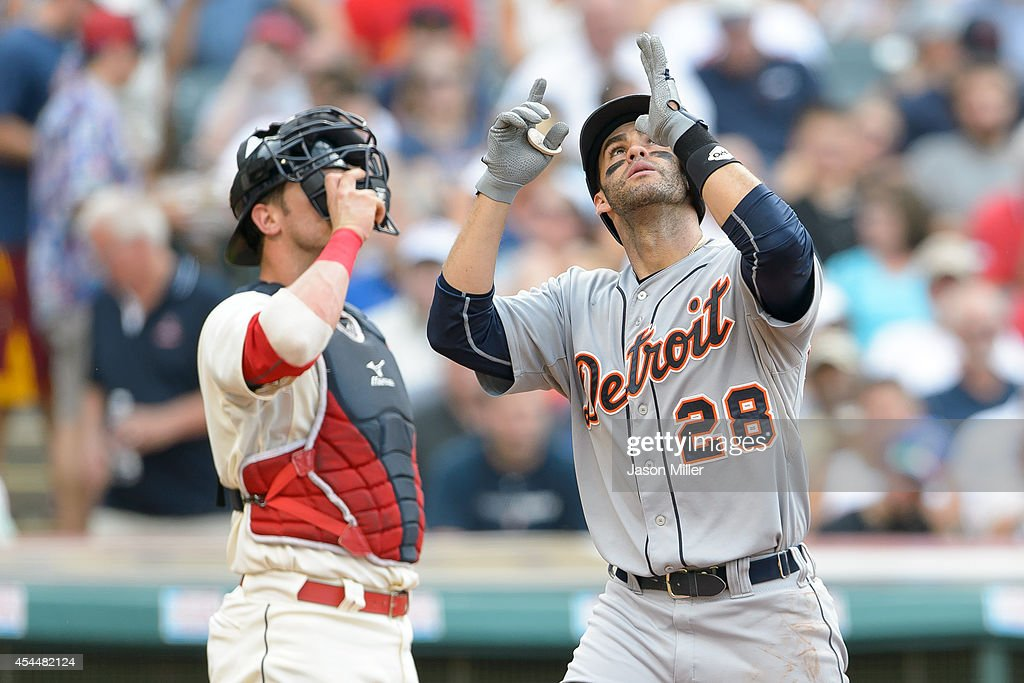 Catcher <a gi-track='captionPersonalityLinkClicked' href=/galleries/search?phrase=Yan+Gomes&family=editorial&specificpeople=9004037 ng-click='$event.stopPropagation()'>Yan Gomes</a> #10 of the Cleveland Indians watches as <a gi-track='captionPersonalityLinkClicked' href=/galleries/search?phrase=J.D.+Martinez&family=editorial&specificpeople=7520024 ng-click='$event.stopPropagation()'>J.D. Martinez</a> #28 of the Detroit Tigers celebrates after scoring on a solo home run during the third inning a Progressive Field on September 1, 2014 in Cleveland, Ohio.