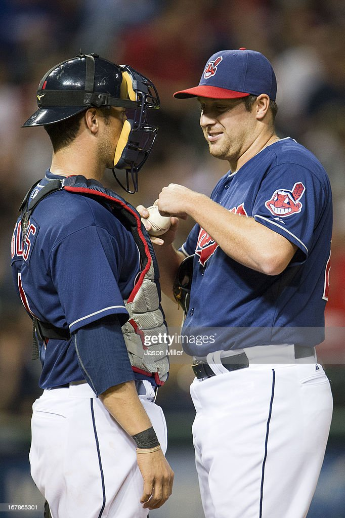 Catcher Yan Gomes #10 talks with relief pitcher Bryan Shaw #27 of the Cleveland Indians during the sixth inning against the Philadelphia Phillies at Progressive Field on May 1, 2013 in Cleveland, Ohio.