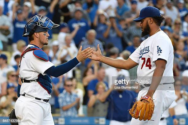 Catcher Yasmani Grandal and pitcher Kenley Jansen of the Los Angeles Dodgers celebrate defeating the San Diego Padres 43 at Dodger Stadium on July 9...