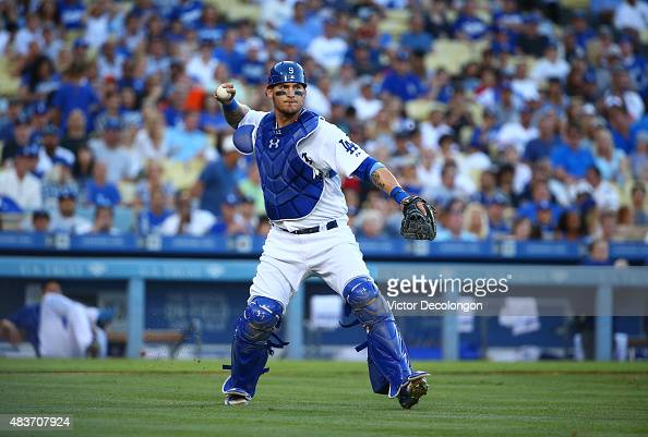 Catcher Yasmani Grandal of the Los Angeles Dodgers throws to first for the force out in the seventh inning during the MLB game against the San...