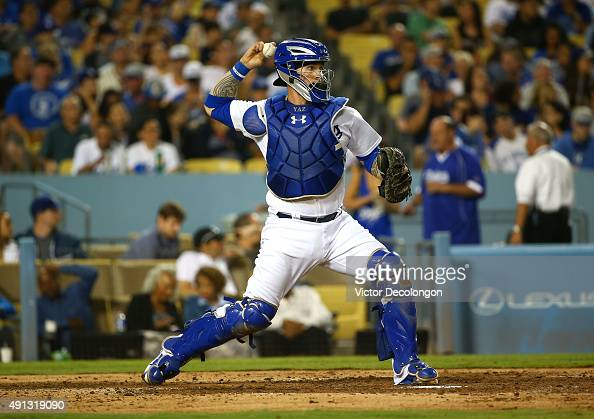 Catcher Yasmani Grandal of the Los Angeles Dodgers throws to second base in the seventh inning during the MLB game against the San Diego Padres at...