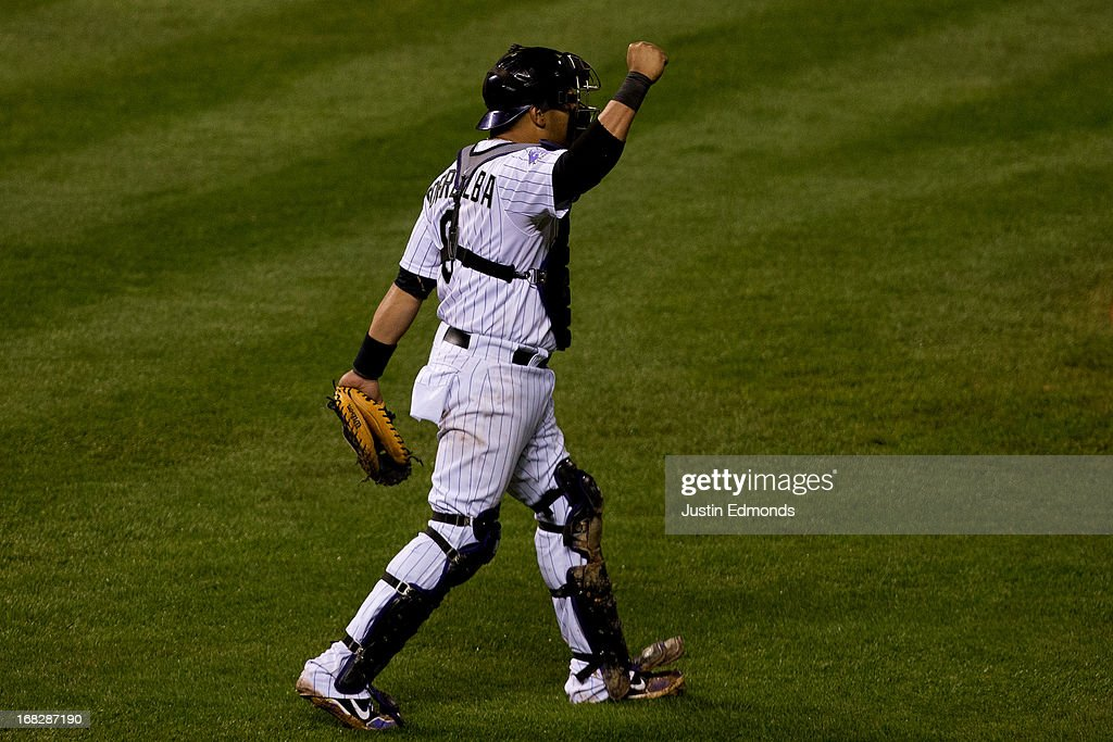 Catcher Yorvit Torrealba #8 of the Colorado Rockies celebrates after the final out of the game against the New York Yankees at Coors Field on May 7, 2013 in Denver, Colorado. The Rockies defeated the Yankees 2-0.