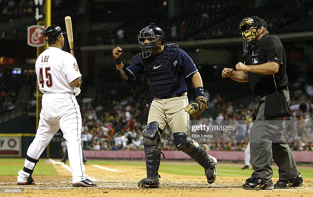 Catcher Yorvit Torrealba of the San Diego Padres pumps his fist as home plate umpire Bob Davidson calls Carlos Lee of the Houston Astros out on...