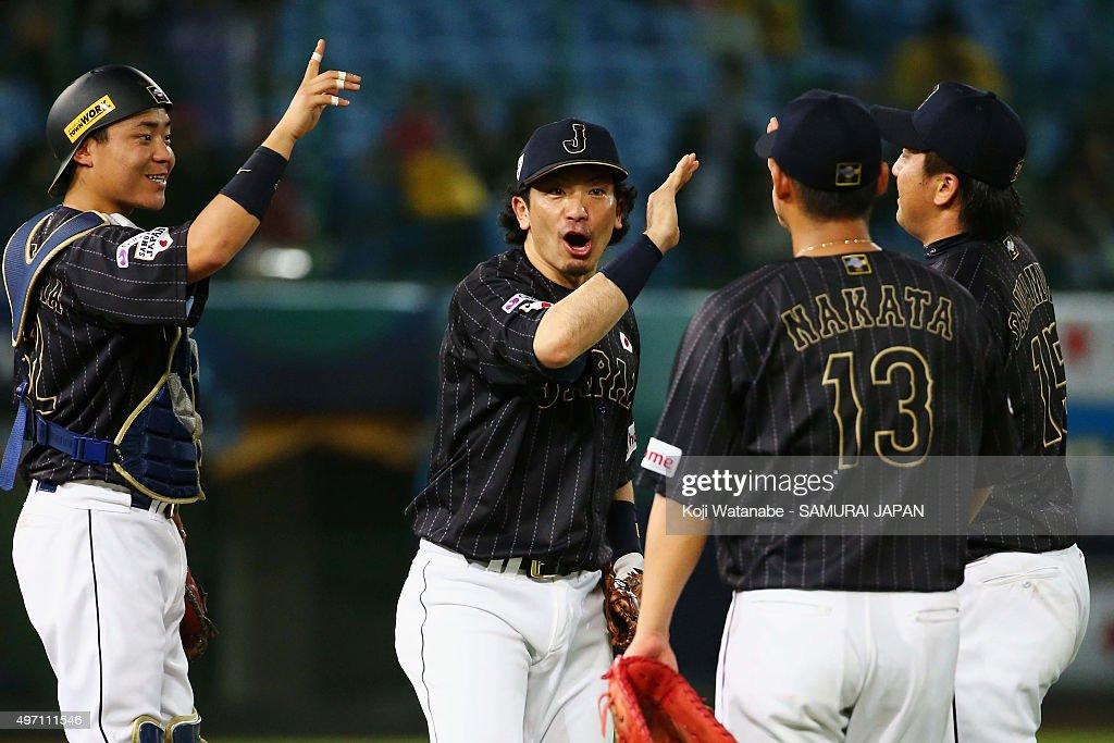 Catcher Yuhei Nakamura infielders Nobuhiro Matsuda Sho Nakata and pitcher Hirokazu Sawamura of Japan celebrate their 102 win in the WBSC Premier 12...