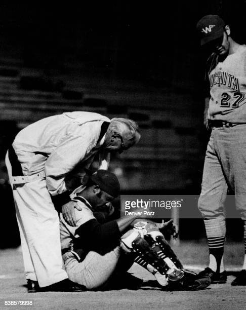 Catcher's Life is not a Happy One It's especially true if one's hit with a foul tip Lou Isaac of Wichita Aeros receives first aid from trainer Bill...