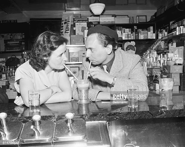 Catching on fast to American ways are Barbara Fitzek from Cologne and Dr Jergen Kakbrenner as they enjoy an ice cream soda at the hotel's drug store...