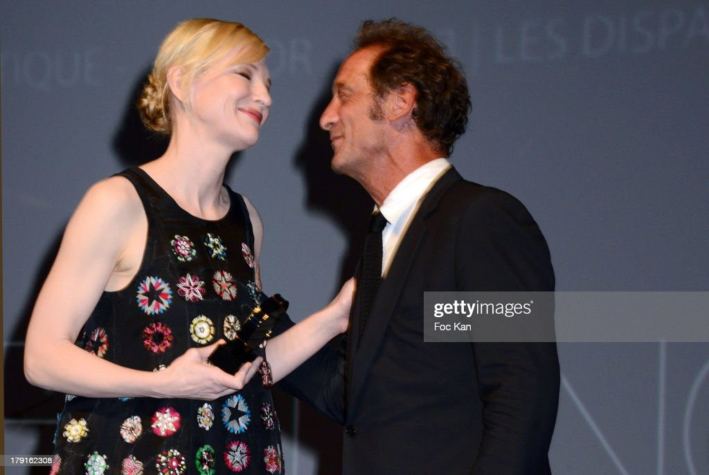 <a gi-track='captionPersonalityLinkClicked' href=/galleries/search?phrase=Cate+Blanchett&family=editorial&specificpeople=201621 ng-click='$event.stopPropagation()'>Cate Blanchett</a> and <a gi-track='captionPersonalityLinkClicked' href=/galleries/search?phrase=Vincent+Lindon&family=editorial&specificpeople=626589 ng-click='$event.stopPropagation()'>Vincent Lindon</a> attend the Tribute to <a gi-track='captionPersonalityLinkClicked' href=/galleries/search?phrase=Cate+Blanchett&family=editorial&specificpeople=201621 ng-click='$event.stopPropagation()'>Cate Blanchett</a> Ceremony during the 'Blue Jasmine' Premiere at the 39th Deauville Film Festival at the CID on August 31, 2013 in Deauville, France.