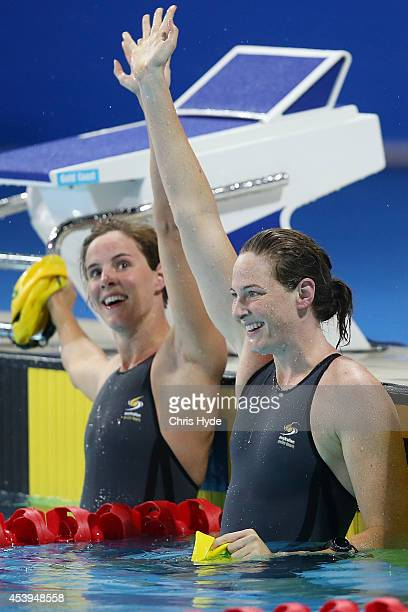 Cate Campbell and Bronte Campbell celebrate after coming first and second in the Women's 100m Freestyle final during day two of the 2014 Pan Pacific...