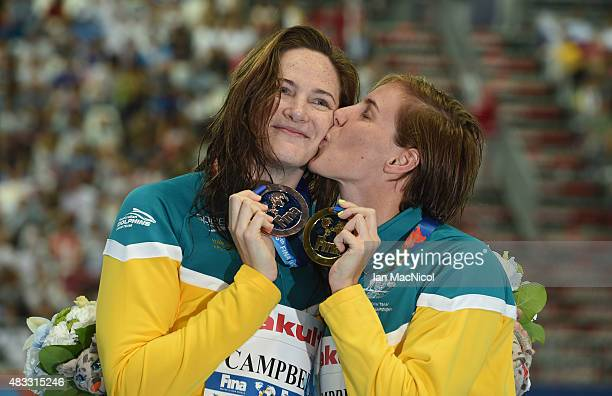 Cate Campbell and Bronte Campbell of Australia celebrates after winning gold and bronze in the Women's 100m Freestyle final with her sister Cate...