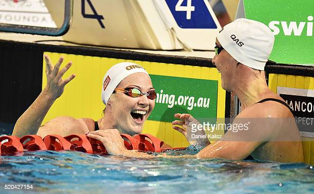 Cate Campbell of Australia and Bronte Campbell of Australia react after the Women's 100 metre Freestyle during day five of the Australian Swimming...
