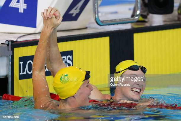 Cate Campbell of Australia celebrates winning the gold medal with silver medallist Bronte Campbell of Australia after the Women's 100m Freestyle...