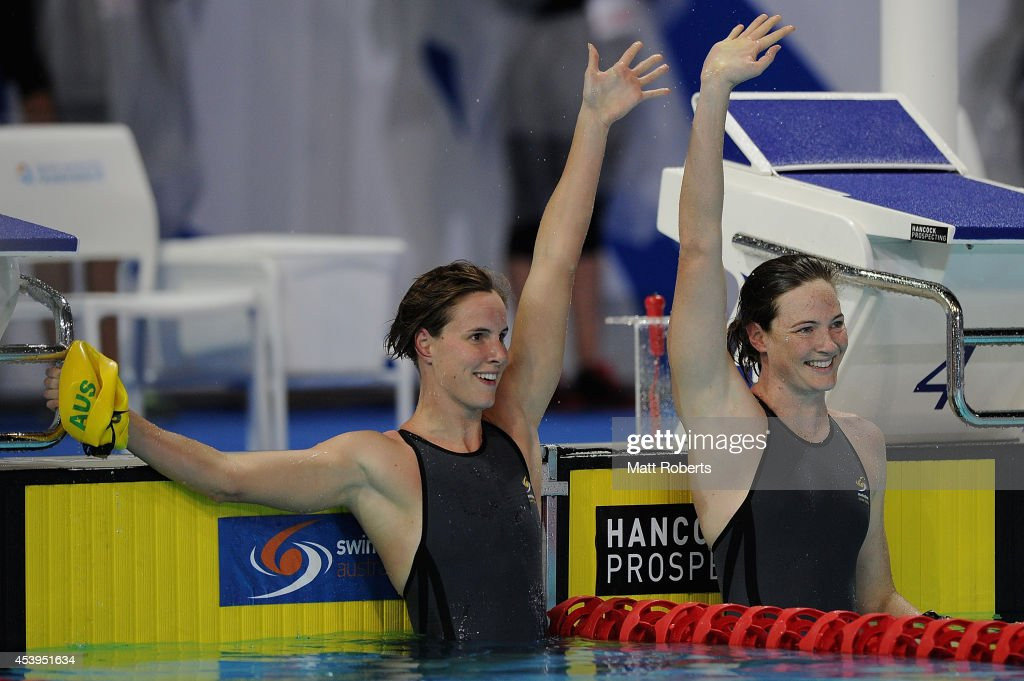 Cate Campbell of Australia celebrates winning the Women's 100m Freestyle Final with Bronte Campbell during day two of the 2014 Pan Pacific...