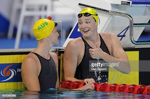 Cate Campbell of Australia celebrates winning the Women's 50m Freestyle Final with Bronte Campbell of Australia during day four of the 2014 Pan...