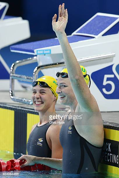 Cate Campbell of Australia celebrates with her sister Bronte Campbell after winning the Women's 50m Freestyle Final during day four of the 2014 Pan...