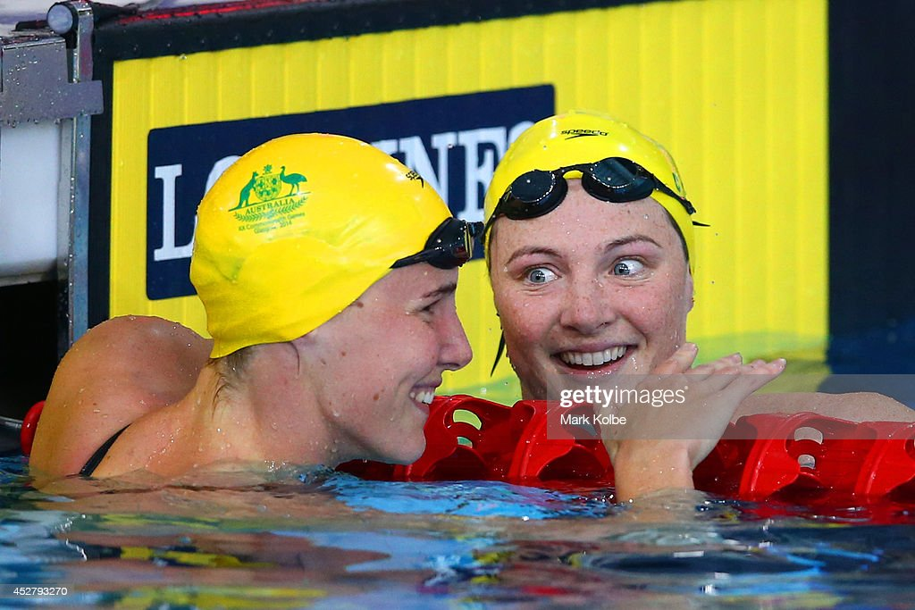<a gi-track='captionPersonalityLinkClicked' href=/galleries/search?phrase=Cate+Campbell+-+Swimmer&family=editorial&specificpeople=4115465 ng-click='$event.stopPropagation()'>Cate Campbell</a> (R) of Australia smiles with <a gi-track='captionPersonalityLinkClicked' href=/galleries/search?phrase=Bronte+Campbell+-+Swimmer&family=editorial&specificpeople=7631918 ng-click='$event.stopPropagation()'>Bronte Campbell</a> of Australia after the Women's 100m Freestyle Semi-final 2 at Tollcross International Swimming Centre during day four of the Glasgow 2014 Commonwealth Games on July 27, 2014 in Glasgow, Scotland.