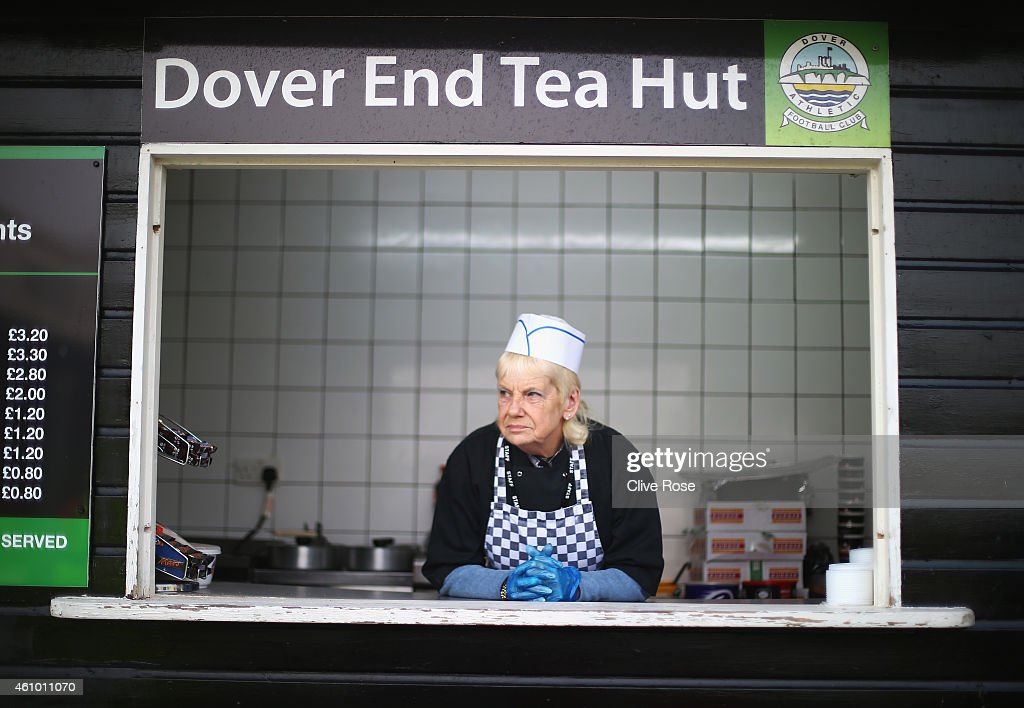 A caterer looks on from the Dover End Tea Hut prior to the FA Cup Third Round match between Dover Athletic and Crystal Palace at Crabble Athletic...