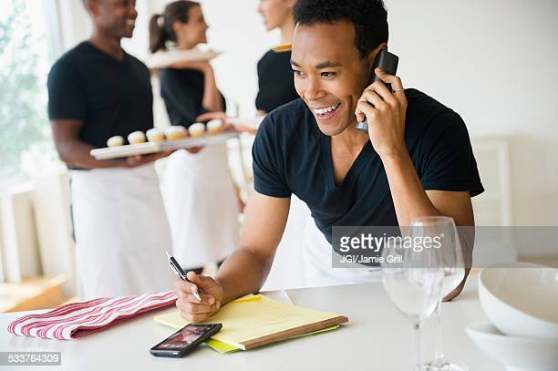 Caterer talking on phone in event space