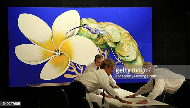 Caterers dress a table in front of a 1988 Brett Whiteley painting titled Hummingbird and Frangipani which is expected to fetch between $16 and $22...
