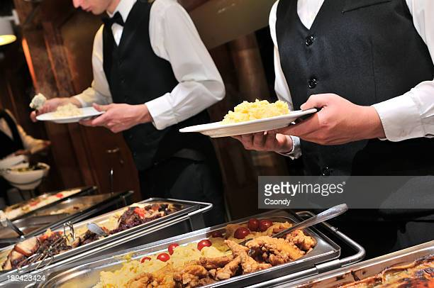 Caterers preparing food ready to be served